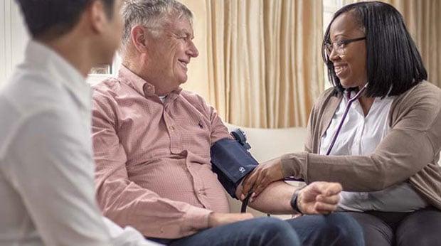 Home care services - senior having blood pressure taken by Registered Practical Nurse