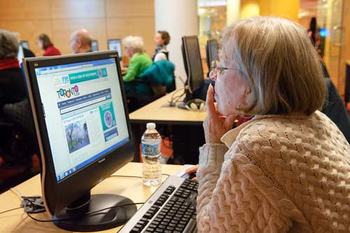 Senior at a computer at the Toronto Public LIbrary
