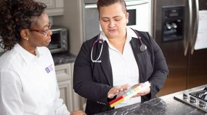 Nurse explaining medications to psw caregiver